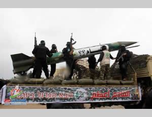 Hamas puts on a display of strength in the Gaza Strip for the 27th anniversary of its founding.