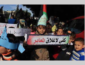 Children demonstrate in front of the UNDP building. The sign reads,
