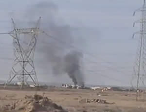Iraqi helicopter shot down by ISIS, on fire (distributed on YouTube)