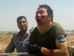 Photo of a Chinese prisoner who fought in the ranks of ISIS (Facebook page of the Iraqi Ministry of Defense, September 1, 2014)