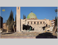 The mosque in Al-Raqqah that was hit by a missile which ISIS claims was fired from the air (IsdaratTube, December 26, 2014).