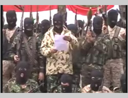 The Sunni tribes' announcement of the establishment of the Popular Resistance Front. The Syrian flag is visible in the background (YouTube, December 27, 2014)