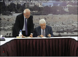 Mahmoud Abbas signs Palestinian application to join twenty international conventions following the failure of the PA resolution to pass in the UN Security Council (Wafa.ps, December 31, 2014).