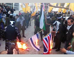 Fatah terrorist operatives burn Israeli, American and British flags.
