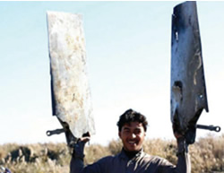 ISIS operative holding the wreckage of the Jordanian aircraft.