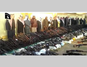 Members of the Al-Shueitat tribe handing over their weapons to ISIS operatives (YouTube, January 11, 2015)