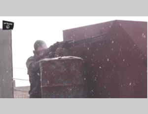 ISIS operatives fighting in Kobani in a heavy snowfall (Facebook page affiliated with the Peshmerga in the Kobani area, January 16, 2015)