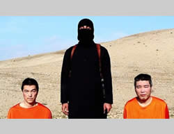 Photo from the video issued by ISIS, threatening to execute two abducted Japanese nationals