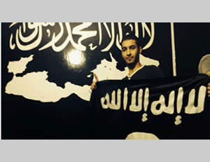 Karim Abu Saleh, one of the network operatives, against the background of an ISIS poster (Israel Security Agency, January 18, 2015)