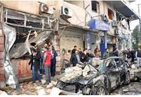 The scene of the car bomb attack in the city of Homs (Syrian TV, January 21, 2015)