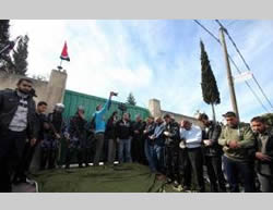 Friday prayer and rally participants in front of the Egyptian embassy in Gaza City.