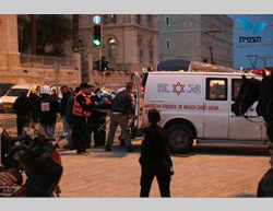 Evacuating the wounded Israeli from the scene of the attack. Right: The site of the attack (Photo by Hillel Meir for Tazpit.org.il, February 22, 2015).