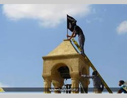 Hoisting the ISIS flag.