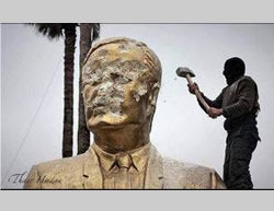 Smashing a statue of Syrian President Hafez Assad, Bashar's father, when the city of Idlib was captured (PALDF Facebook page, March 28, 2015)