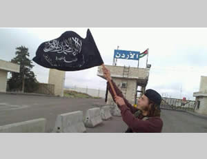 Al-Nusra Front operative waving the organization's flag at the Al-Naseeb border crossing between Syria and Jordan (Al-Arabiya TV, April 11, 2015)