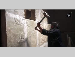 Photos from a video distributed by ISIS showing the destruction of historical artifacts in the ancient city of Nimrud (YouTube, April 12, 2015)
