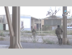 Photo from the video showing ISIS operatives moving in the refinery compound in Baiji