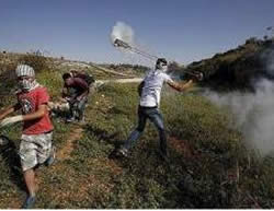 Masked Palestinian rioters clash with the Israeli security forces near the Ofer jail (Facebook page of PALDF, May 1, 2015).