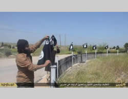 ISIS flags hanging in the town of Sarrin (ISIS-affiliated Twitter account, May 3, 2015)