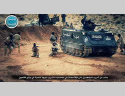 Al-Nusra Front operatives training with the support of APCs in the Al-Qalamoun Mountains