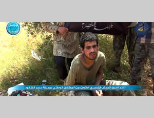 Syrian soldier who, according to Al-Nusra Front operatives, was captured after escaping from the hospital in Jisr al-Shughur (Al-Nusra Front-affiliated Twitter account, May 23, 2015)