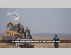 Scenes from a video broadcast by Al-Aqsa TV about the construction of the road near the border security fence east of Rafah.