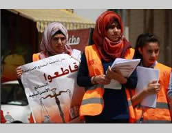 Activists of the Palestinian National Initiative (headed by Mustafa Barghouti) in Hebron, part of the campaign to boycott Israeli-made goods (Wafa.ps, June 7, 2015).