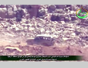 Hezbollah jeep damaged by an anti-tank missile fired in the area of Al-Rahwe, in the western Al-Qalamoun Mountains