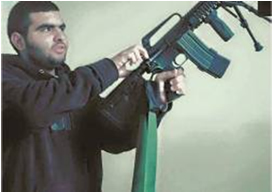 Rock-thrower Muhammad al-Kusba, armed with a rifle (Facebook page of QudsN, July 4, 2015).
