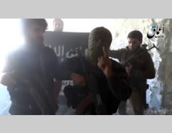 ISIS operatives against the background of an ISIS flag in the city of Al-Zabadani (YouTube, July 11, 2015)