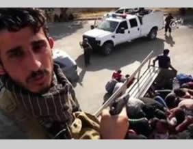 Hijazi in a video in which he and other ISIS operatives execute Iraqi Army soldiers (theshamnews.com, July 12, 2015).