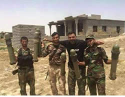 Iraqi Army soldiers displaying seized American missiles.