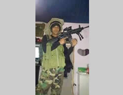 Muhammad Abu Latifa armed and in uniform (Facebook page of PALDF, July 27, 2015).