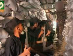 Campers in the northern Gaza Strip hold a military exercise in a simulated tunnel in the northern Gaza Strip.