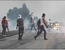 Palestinians clash with Israeli security forces at the entrance to the village of Duma (Wafa News Agency, August 2, 2015).