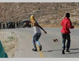 Masked Palestinians riot and clash with IDF forces in the village of Duma after the funeral of Sa'ad Dawabsha (Wafa News Agency, August 8, 2015).