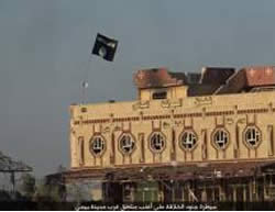 ISIS flag waving on the Al-Baraka Hotel in Baiji (Justpaste.it file-sharing website, August 22, 2015).
