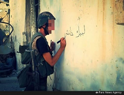 Graffiti in support of Iranian Supreme Leader Ali Khamenei, on a wall in Zabadani after pro-Syrian regime forces occupied parts of the city.
