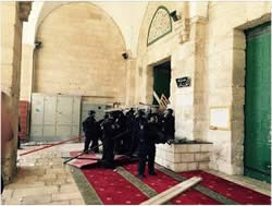 Clashes on the Temple Mount between masked men and the Israeli security forces (Israel Police Facebook page, September 13, 2015).