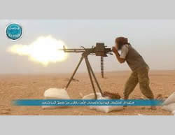 Al-Nusra Front operative firing at the Syrian regime forces in the area of Khanaser-Ithriya (Twitter account affiliated with the Al-Nusra Front, October 5, 2015).