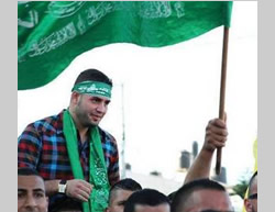 Bilal Abu Ghanam wears a Hamas headband on the day of his release from an Israeli jail (Facebook page of PALDF, October 13, 2015).