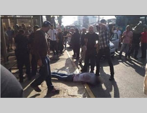 The injured terrorist stabber lies on the main street in Raanana