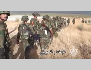 Syrian Army tank and soldiers in the village of Atshan (SANA News Agency, October 11, 2015)