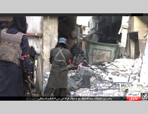 ISIS operatives near checkpoints taken over from the rebel forces in Damascus's Al-Tadamon neighborhood (ISIS-affiliated Twitter account, October 16, 2015)