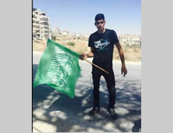 Ahmed Taha from the village of Qatanna with a Hamas flag (Facebook page of Qatanna, November 23, 2015).