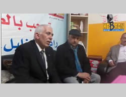 Kamel Hamid, governor of the Hebron district, visits the offices of Al-Khalil radio after the IDF raid in a show of solidarity (Facebook page of the governor of Hebron and the Facebook page of Al-Khalil radio, November 22 2015).