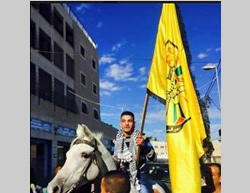 Ayman Samih al-Abassi carries a Fatah flag on his release from an Israeli jail  (Facebook page of QudsN, November 29, 2015).