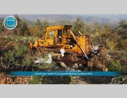 Syrian Army bulldozer that fell into the hands of the Al-Nusra Front in Jabal al-Zahiyah (Al-Nusra Front-affiliated Twitter account, November 27, 2015)