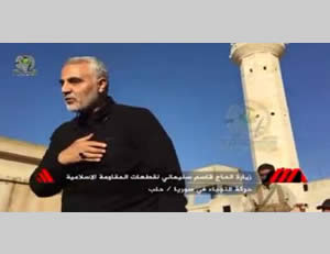 Qassem Soleimani appearing in Aleppo before operatives of an Iraqi Shiite militia handled by Iran
