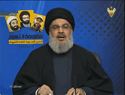 Hassan Nasrallah speaking at a memorial ceremony on the anniversary of the deaths of three senior Hezbollah operatives (the